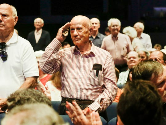 U.S. Army veteran Sid Hardy salutes as local veterans are honored during Songs of Remembrance Concert at The Bayou Church May 29, 2016.