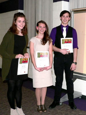 Senior Christopher Kelly, right, won the 2016 Cedar Crest High School Poetry Out Loud finals. All of the finalists performed two poems. Senior Page Olsen, center, came in second place, and sophomore Brook Halinar took third place. The Poetry Out Loud: National Recitation Contest encourages the nation's youth to learn about great poetry through memorization and recitation. This year, more than 7,000 students in over 100 high schools across the commonwealth participated in this exceptional contest.