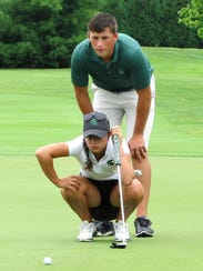 Brighton's Allyson Geer, lining up a putt with caddy