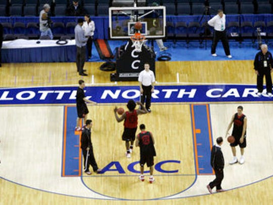 "FILE - In this March 12, 2008, file photo, Maryland players practice for the Atlantic Coast Conference men's NCAA college basketball tournament at Bobcats Arena in Charlotte, N.C.  The NCAA says it will consider North Carolina as a host for championship events again after the state rolled back a law that limited protections for LGBT people. In a statement Tuesday, April 4, 2017, the governing body said its Board of Governors had reviewed moves to repeal repealed the so-called ""bathroom bill"" and replace it with a compromise law."