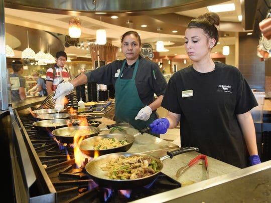 Gabrielle Wilson, right, works the stir-fry line at Durrell Hall at Colorado State University on Sept. 28.
