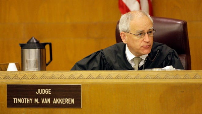Judge Timothy Van Akkeren gives the jury instructions Thursday, June 20, 2013, after closing arguments in Nathan Paape's murder trial.