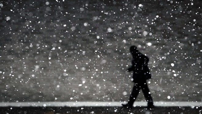March 3, 2014 - A traveler at the Memphis Airport hustles through the flakes of falling snow to make his flight Monday morning after a winter storm covered parts of Memphis in a blanket of ice over night. (Jim Weber/The Commercial Appeal)