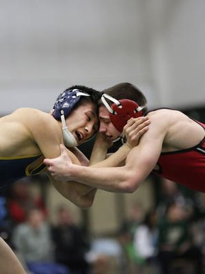 Frank Lor (left), of Wausau West, faces off against Chance Bailey, of Stevens Point, during the 126-pound bout of the WIAA wrestling sectionals at D.C. Everest High School on Feb. 20.