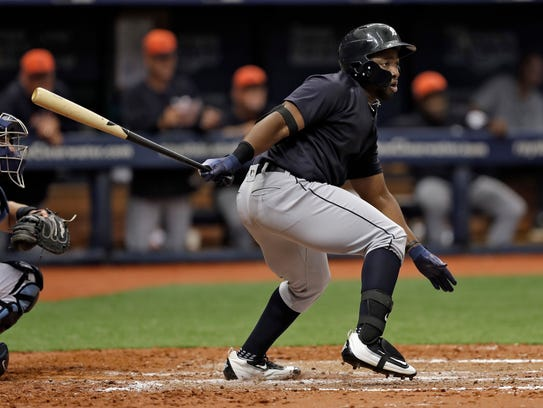 Christin Stewart follows through on his RBI single against the Rays during an exhibition March 27.