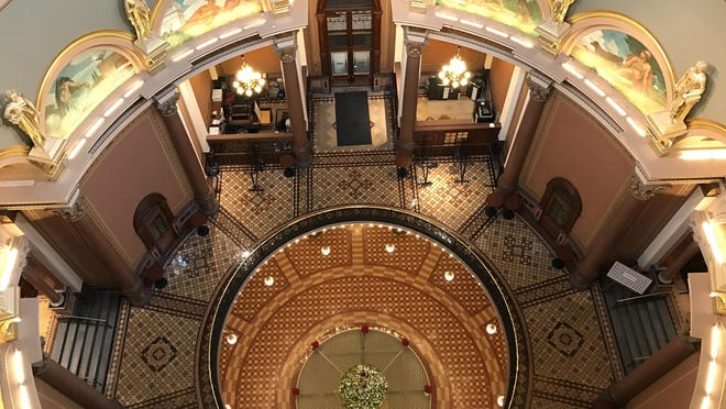 A view looking down the Iowa State Capitol rotunda with the Senate entrance to the left, the House at right and the Library at top in Des Moines.