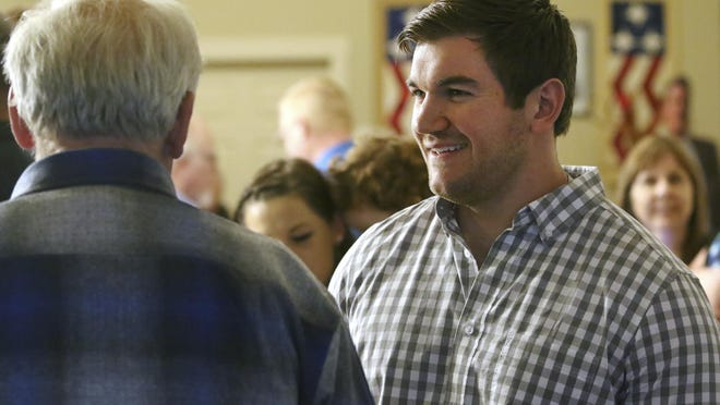 Alek Skarlatos, right, speaks with former Douglas County Commissioner Mike Winters at the Douglas County Republican Party headquarters in Roseburg.