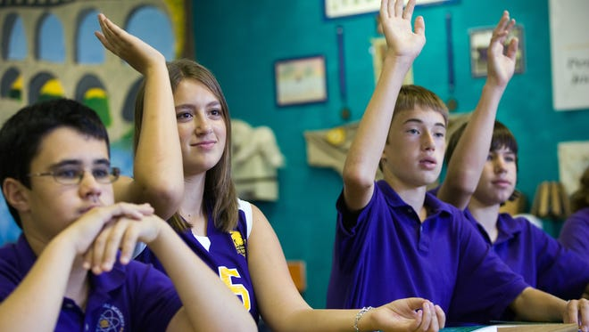 Students answer questions during Latin class at Gilbert Classical Academy in this file photo from 2009. The school is one of the best in the nation, but it is having trouble expanding.