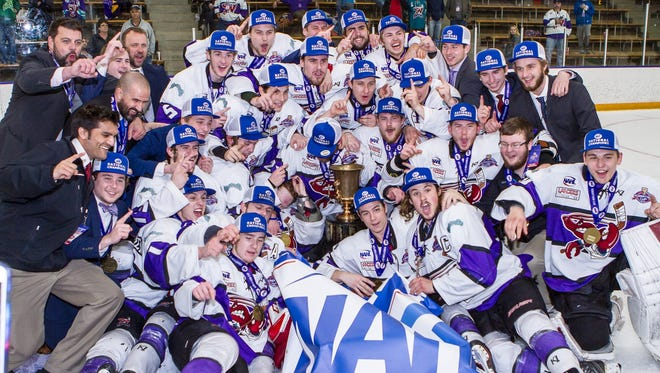 The Shreveport Mudbugs pose with the Robertson Cup after their victory Monday.