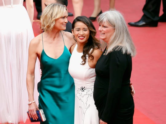 """(R-L) Writer Denise Meyers, actress Nini Le Huynh and director Robin Wright attends the """"Loveless (Nelyubov)"""" screening during the 70th annual Cannes Film Festival at Palais des Festivals on May 18, 2017 in Cannes, France."""