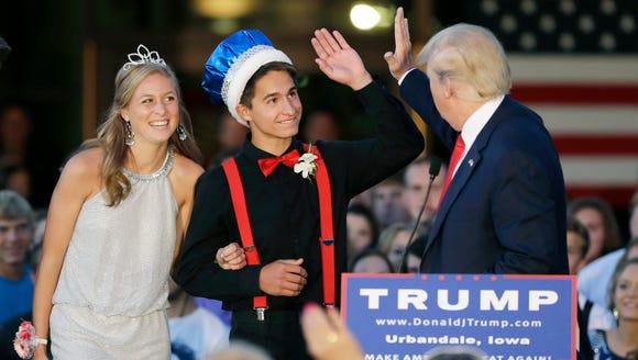 Donald Trump high-fives homecoming king Austin Cook