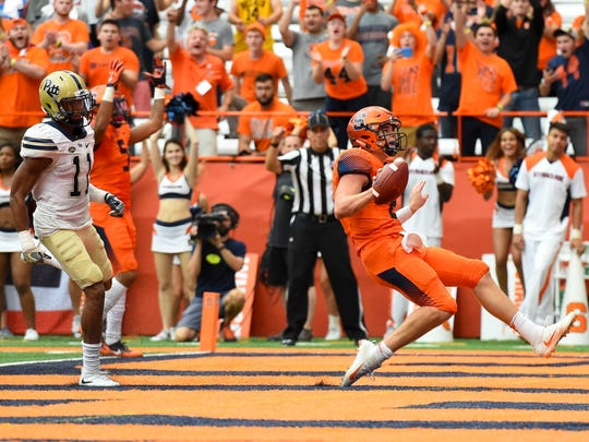 Syracuse Orange quarterback Eric Dungey runs into the end zone for a touchdown in front of Pittsburgh Panthers defensive back Dane Jackson during the third quarter at the Carrier Dome.
