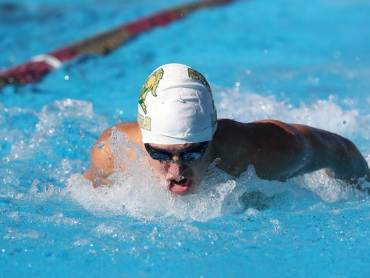 Joshua Lamar of Lincoln swims the 200 IM during the
