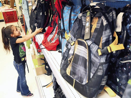 Robin Zielinski   Sun-News file photo   Yasmine Hernandez, 6, of Las Cruces, looks at the selection of backpacks last year at Target during Tax-Free Weekend.