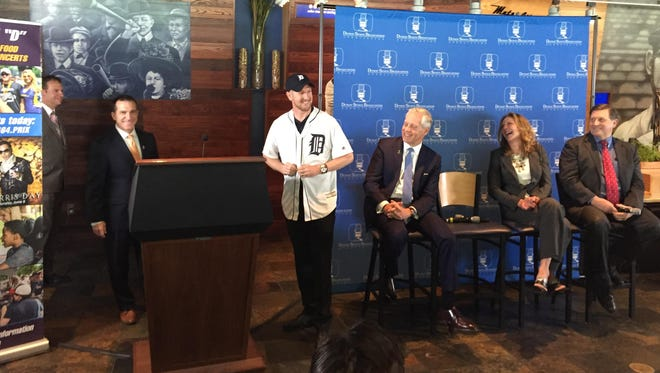 Race driver Charlie Kimball with a No. 83 club jersey at Comerica Park on Wednesday.
