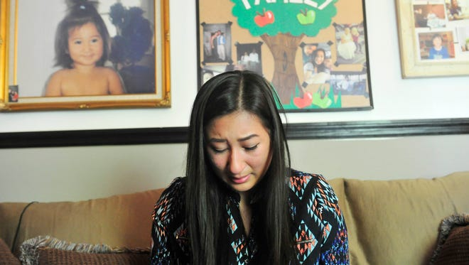 An emotional Geraldine Hernandez talks about her her job and not attending college in Nashville, Tenn. September 18, 2015. Hernandez had problems with federal aid application and did not go to school this semester.