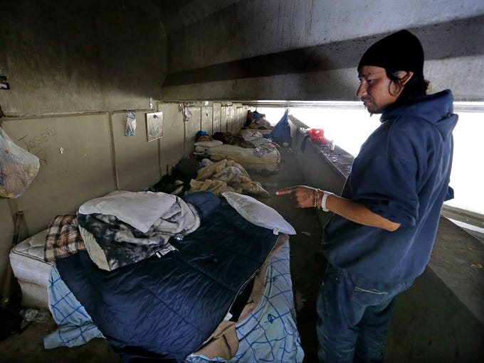 Victor Truillo looks at his living arrangements in
