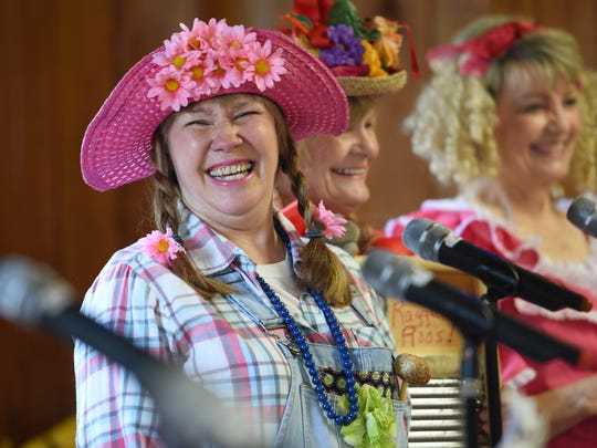 Debbie Keen laughs after delivering a joke as the Ragger Roos Comedy Washboard Band performs for the Harvest Fest party for Hinds' Institute of LIfelong Learning in Raymond recently.