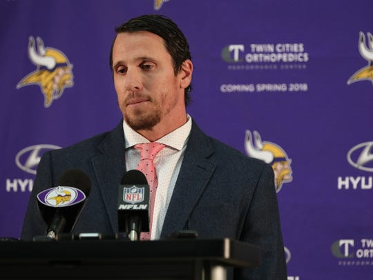 Chad Greenway pauses during a news conference in Eden