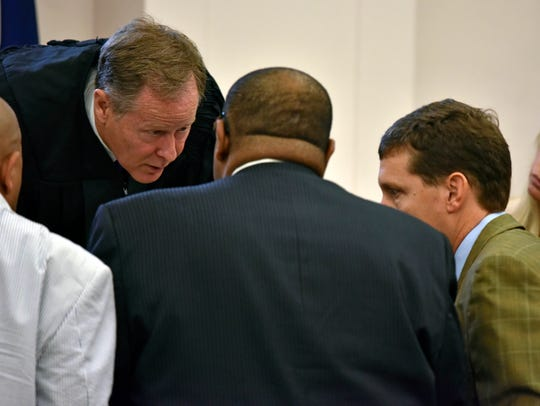 Hinds County Circuit Court Judge Jeff Weill, center,