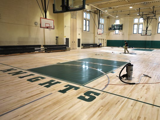 A new gym floor at Isaac E. Young Middle School was