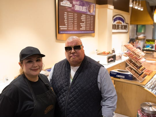 Precious and Gabe Alvarado recently opened their Rocky Mountain Chocolate Factory store in La Palmera mall. The couple also recently wrote a book about their experiences after Gabe was badly burned and lost an arm in a refinery fire in July 2009.