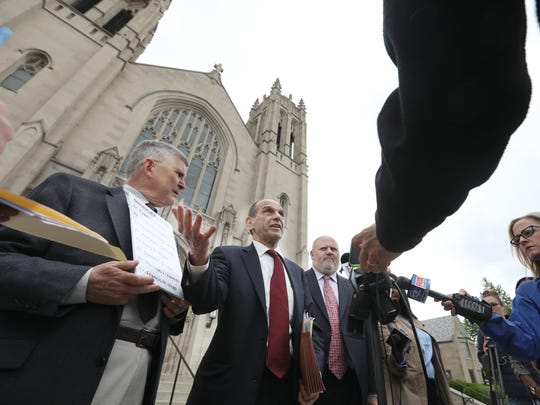 Mitchell Garabedian, Boston attorney who has represented over 3000 victims of clergy abuse, center, flanked by Robert Hoatson, former priest and founder of Road to Recovery, a victimÕs support organization, left, and James Faluszczak, survivor of abuse and former priest, right, hold a press conference on Diocese of Rochester priests accused of abuse outside the Diocese of Rochester on Flower City Park in Rochester Wednesday, June 6, 2018.