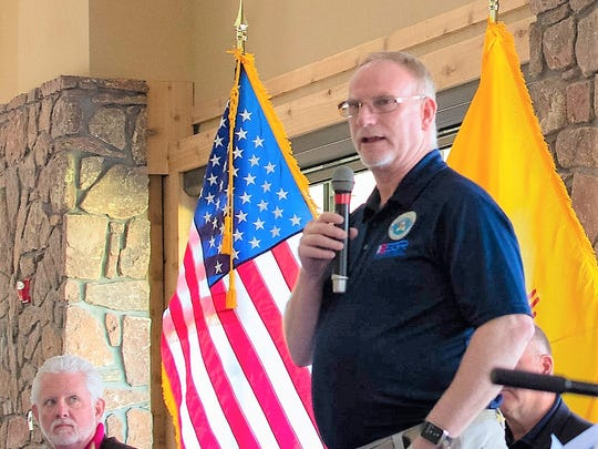 Mark Gordon, ESGR New Mexico State Chairman, speaks at the luncheon. Seated at lt left is Ruidoso Mayor Lynn Crawford.