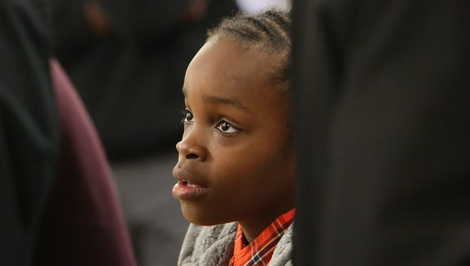 Chris Rogers, 9, listens to extra advice after a session during the Raising Kings event at P.S. duPont Middle School Saturday.