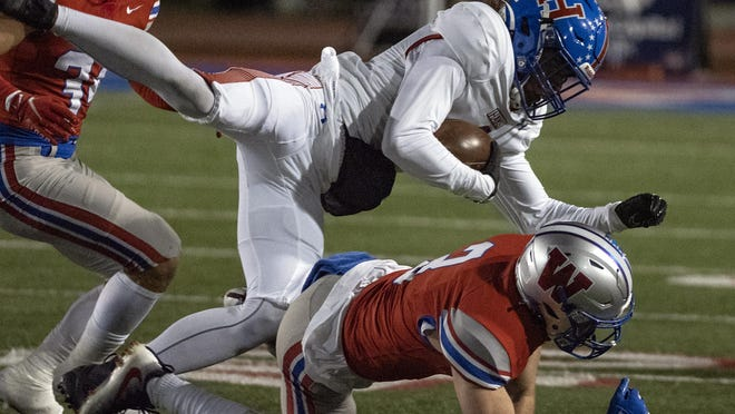 Westlake senior cornerback Lucas Mireur, tackling Hays running back Bryant Lewis, has helped a defense that has posted three shutouts in five games. The Chaps will be the defending Class 6A Division II state champions when playoffs start in December.