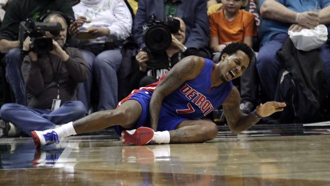Pistons guard Brandon Jennings shouts after falling to the floor while playing against the Bucks on Jan. 24 in Milwaukee.