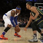 Knicks forward Carmelo Anthony, shown being guarded by Utah Jazz guard Dante Exum during Wednesday night's game, will be starting for the East in the NBA All-Star Game.