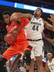 Michigan State's Nick Ward goes for the rebound against