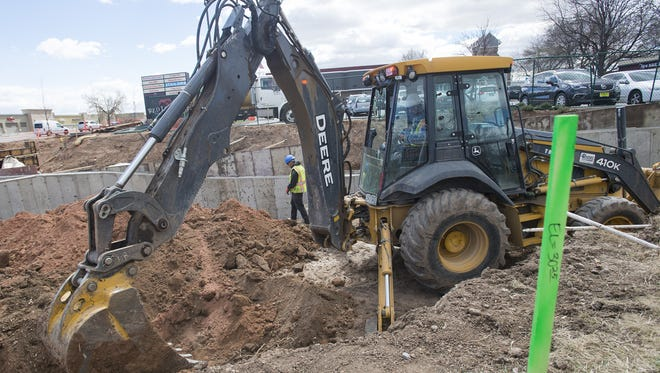 Construction continues on an underpass of College Avenue near the Foothills shopping center in Midtown Fort Collins on March 24, 2017. Buried utility services are causing underpass projects in Fort Collins to take longer than anticipated.