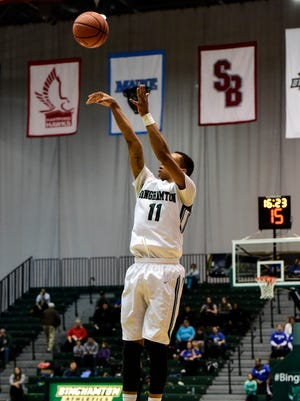 Binghamton's Romello Walker takes a jump shot against St. Bonaventure during a men's basketball game in the Events Center on Dec. 20, 2014.