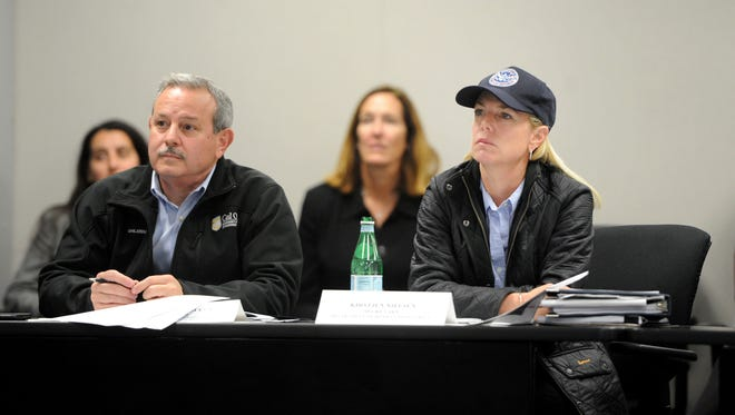 Mark Ghilarducci, left, California Governor's Office of Emergency Services director and Homeland Security Secretary Kirstjen M. Nielsen, right, watch a slide presentation on the Thomas Fire at the Ventura County Government Center earlier this month.