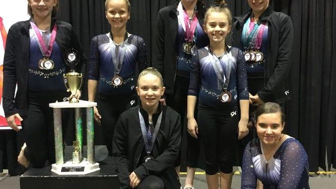 From left are Level 4 gymnasts Allison Radcliff, Addison Adams, Zoe Randall, Victoria Payne, Maddi Taron, Trinity Rakestraw and Calista Schardt.