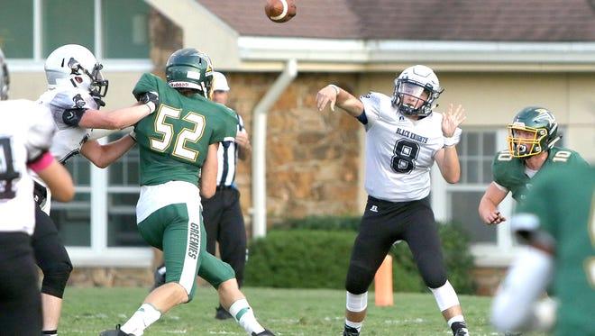 Robbinsville's Alex Bridges attempts a pass in Thursday's game at Christ School.