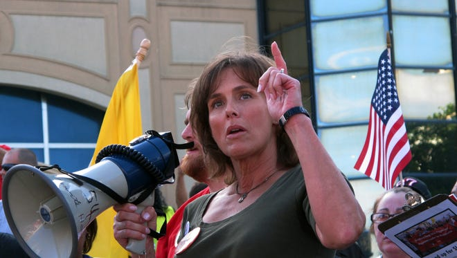 Dawn French, a cocktail server at Trump Plaza, speaks at a rally in Atlantic City N.J. on Thursday July 24, 2014, to protest the planned closing of her casino and as many as two more by September. Trump Plaza, the Showboat and Revel all could be closed by the end of September.(AP Photo/Wayne Parry)