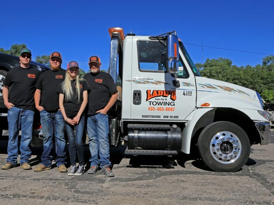Ladd Brindley, right, employs his three adult children, (from left) Wyatt, Laramy and Jessi, in his Cedar City business, Ladd's Towing.