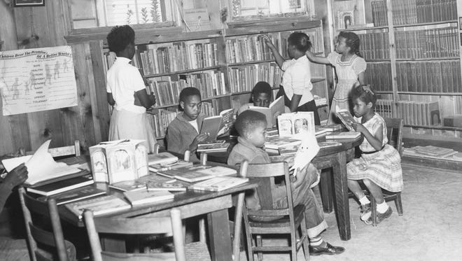 Young readers at the Dunbar Library in 1954.