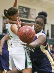 Leigh's Staelle Larenre (43) tries to save the ball from going out of bounds agains Fort Myers defender Jarya Outten (2) during the ladies basketball game at Fort Myers High School in Fort Myers, FL on Friday, January 29, 2016.  Fort Myers defeated Lehigh to win the Deistrict 6A-11 Championship.  Photo by Gregg Pachkowski