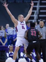 Dainius Chatkevicius (14) defends against Arkansas State's Tamas Bruce at the Ford Center Friday night. The Purple Aces beat the Red Wolves 77-63.