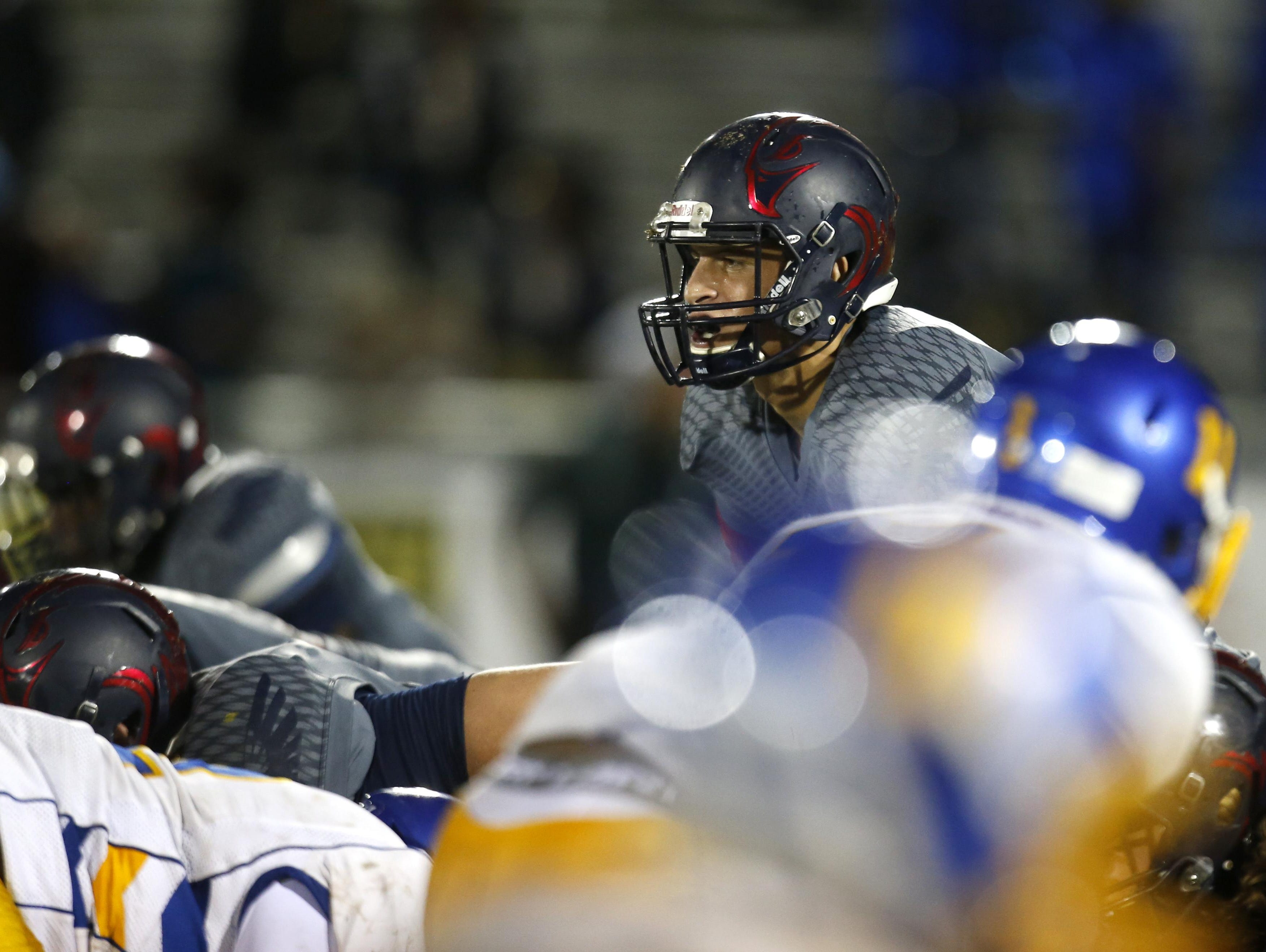 Wakulla quarterback Feleipe Franks goes under center for a play during a game against Rickards last Friday. On Monday, Franks opened up his recruitment by decommitting from LSU.