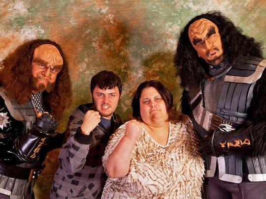 """Kim Huff and her son Jonny ham it up with """"Star Trek: Deep Space Nine"""" Klingon actors Robert O'Reilly (Gowron, left) and J.G. Hertzler (Martok) in 2012."""