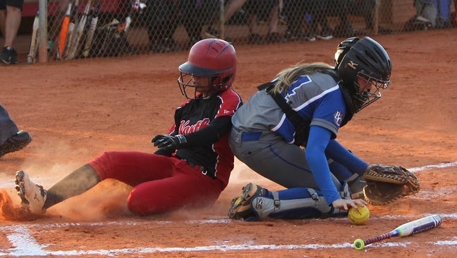 Barron Collier catcher Chloe Freuischmidt can't hold onto the throw as North Fort Myers runner Sajarie Jones slides into home plate Tuesday at the Region 3A-3 softball game.