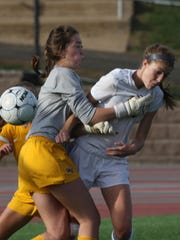 Bernards Township, Watchung Hills goalie Kaylee Donnelly, left, defends against Ridge's Shannon Keefe during game action at Ridge of the girls soccer North 2 group IV semifinals. Monday Nov. 9, 2015. (Brian Price for The courier News)