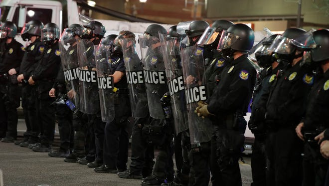 Phoenix police move protesters away after using gas outside the Phoenix Convention Center on Aug. 22, 2017, in Phoenix. Protests were held against President Donald Trump as he hosted a rally inside the convention center.
