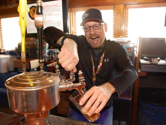 Vince Wright, head brewer at Fin City pours beer at
