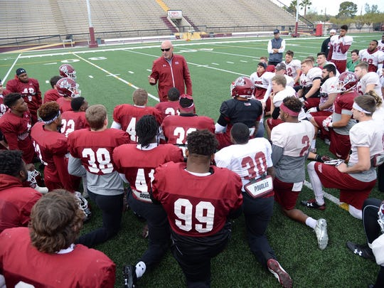 New Mexico State football coach Doug Martin and the Aggies practiced on Wednesday at Salpointe Catholic High School in Tucson, Arizona ahead of Friday's Arizona Bowl game against Utah State.